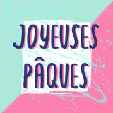 Happy Easter greeting card with hand drawn lettering. French Easter greeting card Joyeuses Paques with hand drawn lettering on pastel art background, design Royalty Free Stock Photos