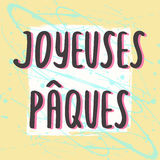 Happy Easter greeting card with hand drawn lettering. French Easter greeting card Joyeuses Paques with hand drawn lettering on pastel art background, design Royalty Free Stock Image