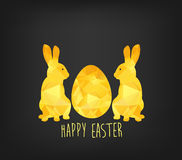 Happy Easter greeting card in low poly triangle style. Flat design polygon of golden easter egg and bunny isolated on black backgr Stock Photography
