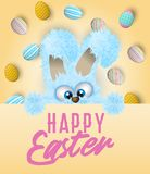 Happy Easter greeting card with painted or decorated eggs and blue fluffy bunny that is peeping out. Stock Photos