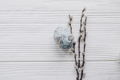 Happy easter greeting card. simple easter egg with chick ornamen. Ts and willow buds on rustic white wooden desk background. with space for text, top view. soft Stock Image