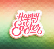 Happy Easter greeting card with triangles. Happy Easter greeting card. Polygonal mosaic background. Easter typographic background. Happy easter hand lettering Stock Photo