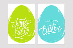 Happy Easter greeting cards with handwritten holiday wishes and brush stroke egg shape background. Royalty Free Stock Images