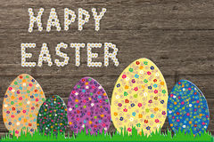 Happy easter greeting with colorful patterned eggs and easter te. Easter greeting with colorful patterned eggs and happy easter text on rustic wooden background stock images