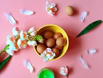 Happy Easter Eggs Red Grapefruits  Protein vitamin Pink white apple flowers  green aroma  candle yellow plate on pink  Healthy  f royalty free stock photography