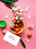 Happy Easter Eggs Red Grapefruits  Pink white apple flowers  green aroma  candle yellow plate on pink background Healthy  f stock photo