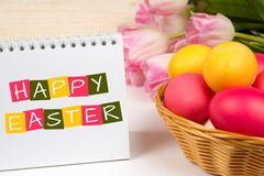 Happy easter, greetings card. With tulips and eggs in basket Royalty Free Stock Photos