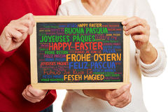 Happy Easter greetings in many languages Stock Photos