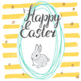 Happy Easter hand drawn greeting card with lettering and sketched doodle cute rabbit in easter egg shape on color background Stock Images