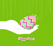 Happy easter hand holding a egg Royalty Free Stock Images