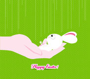 Happy easter hand holding a tiny bunny Stock Image
