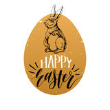 Happy Easter hand lettering greeting card. Vector sketched paschal bunny illustration on egg background forposter etc. Royalty Free Stock Image