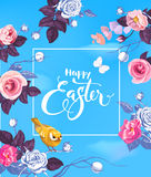 Happy Easter hand lettering in square frame, half-colored roses, small yellow bird sitting on branch against blue sky on Stock Images
