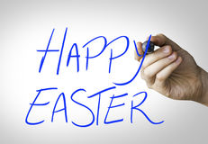 Happy Easter hand writing on blue marker on transparent wipe board Stock Photography