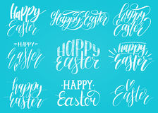 Happy Easter handwritten lettering set.Religious calligraphy collection on blue background for greeting cards, tags etc. Royalty Free Stock Photos