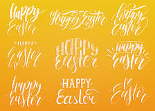 Happy Easter handwritten lettering set.Religious calligraphy collection on yellow background for greeting cards,tags etc Stock Photography