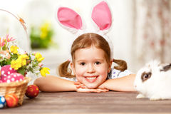 Happy easter! happy funny child girl playing with bunny Stock Photo