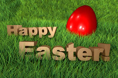 Happy Easter holidays greetings card 3D on grass. Happy Easter holidays greetings card. 3D golden letters rendered on grass with a red easter egg Stock Images