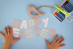 Happy Easter - kids hands 4 Stock Image