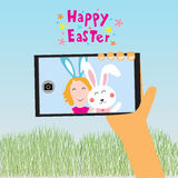 Happy easter kids selfie with rabbit on smart phone  Royalty Free Stock Image