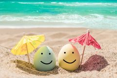 Happy Easter Lettering Background With Eggs On The Sandy Beach Royalty Free Stock Images