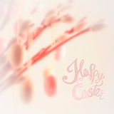 Happy Easter lettering with bokeh willow tree and decorations Stock Images