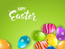 Happy Easter Lettering card whith decorated colorful eggs on green background Royalty Free Stock Photos