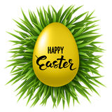 Happy Easter Lettering on decorated gold egg on fresh green grass on white background. Happy Easter Lettering on Easter eggs in a field of grass Stock Photo