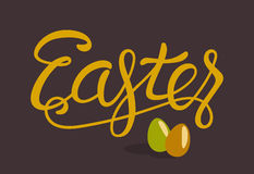 Happy Easter Lettering with Eggs Isolated on Brown Royalty Free Stock Images