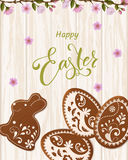 Happy Easter lettering, Gingerbread in the form of eggs. Spring holidays, Easter background Stock Photo