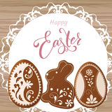 Happy Easter lettering, Gingerbread in the form of eggs. Spring holidays, Easter background Royalty Free Stock Photo