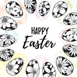 Happy Easter lettering inside hand drawn eggs wreath with floral elements Royalty Free Stock Images