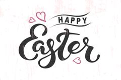 Happy Easter lettering isolated on textured background. Happy Easter text isolated on textured background. Hand drawn lettering as Easter logo, badge, icon Royalty Free Stock Image
