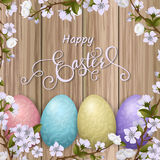 Happy Easter lettering, painted colorful eggs. Spring holidays, Easter background, blossom tree Stock Image