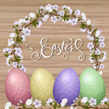Happy Easter lettering, painted colorful eggs. Spring holidays, Easter background, blossom tree Royalty Free Stock Image