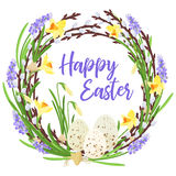 Happy Easter lettering . Spring wreath from branches of willow and flowers decorated with quail eggs and bulbs of Stock Photos