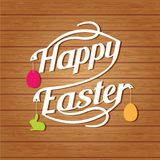 Happy easter lettering. White  letters text  on wood background Stock Photo