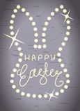 Happy Easter, line lettering in shining bunny head frame Royalty Free Stock Photography