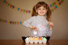 Happy easter. Little girl painter painted eggs. Kid preparing for Easter. Painted hand. Finger paint. Art and craft concept. stock photo