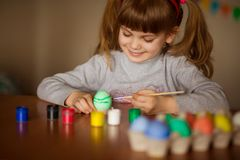Happy easter. Little girl painter painted eggs. Kid preparing for Easter. Painted hand. Finger paint. Art and craft concept. stock images