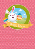 HAPPY EASTER logo with rabbit holding painted eggs in his hands with green mountains and blue sky. With clouds background inside a green circle on pink hearts Stock Image