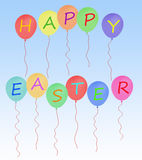 Happy Easter message party balloons on blue Stock Image