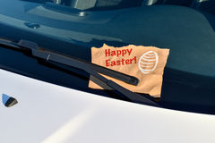 Happy Easter - Message under a windshield wiper Royalty Free Stock Image