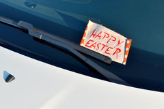 Happy Easter - Message under a windshield wiper Stock Photography