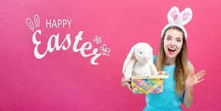 Happy Easter message with woman with Easter basket royalty free stock photo
