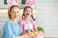 Happy easter!  mother and child daughter with ears hare getting ready for holiday Royalty Free Stock Photo