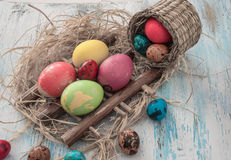 Happy Easter multi-colored eggs on wooden bacground Stock Photo