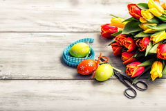 Happy easter. Multicolored spring tulips and Easter eggs. Spring and Easter decorations Royalty Free Stock Images
