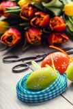 Happy easter. Multicolored spring tulips and Easter eggs. Spring and Easter decorations Royalty Free Stock Photo