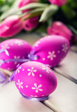 Happy easter. Multicolored spring tulips and Easter eggs. Spring and Easter decorations Stock Photos